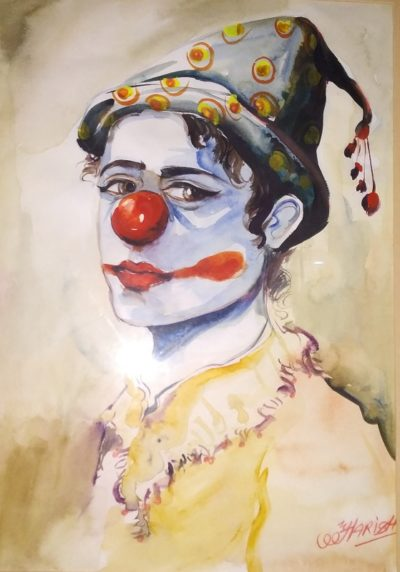 Painting of a sad joker